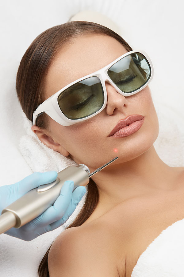 woman getting laser treatment as part of a Fire and Ice Laser Facial at Gleam Medical Spa in Denver, Colorado